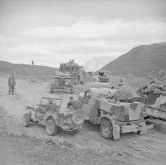 British Army in Italy - Artillery tractors, trucks and jeeps seen on a road near the river Trigno, 8 November 1943.
