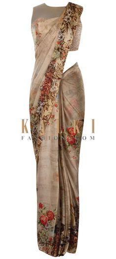 Mud brown printed saree in floral motif only on Kalki