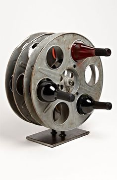 Unique wine rack made from 2 vintage / antique metal movie film reels. The movie reels measure approximately in diameter. It will hold 6 regular sized bottles of wine. Movie Reels, Film Reels, Movie Film, Movie Props, Diy Upcycling, Upcycle, Deco Cinema, Unique Wine Racks, Ideias Diy