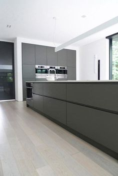 Ultra minimalist family home in black and white modern kitchen sinks, modern kitchen design,