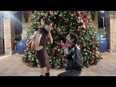 """AJ Lucero surprises his girlfriend, Michelle Loput, one year after they met, at the place they met, with a ring. She was told it was filming for a music video, until he got down on one knee. Music by Michael Buble: """"All I Want for Christmas is You"""". I do not own the rights to this song, and this is a non profit video."""
