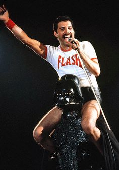 Freddie Mercury on the shoulders of Darth Vader, 1980.