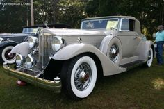 1933 Packard 1005 Twelve Convertible Roadster. Not sure of the coachbuilder but I'll always suggest Ray Dietrich. 142 in wheelbase,445 cu in 160 bhp engine. You can seem the mechanism for the Pilot Rays going to the main car steering on the drivers side .