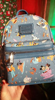 There is nothing better than having fun in the Disney Parks! The new Loungefly backpack celebrates some of our favorite Disney Parks moments with some of