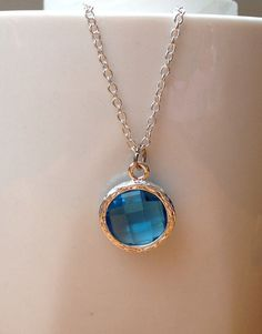 Silver round peacock blue framed crystal necklace. by PetalJewels