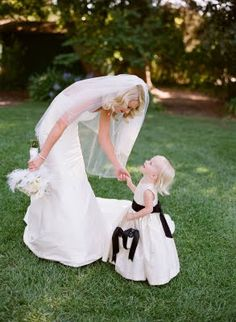 this but with Maddy somehow. Maybe her looking at my bouquet or us in a ring around the rosy dancing pose. Or with all 4 kids