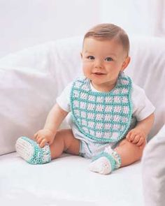This cute little bib and bootie set is a great baby shower gift. Shown in Lily Sugar n Cream. free crochet pattern