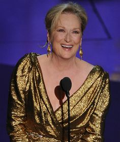 cannot say enough about meryl streep. she stunned in a completely metallic number and gold earrings and walked out with a metallic man.