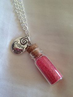 FOLLOW YOUR HEART glass bottle charm necklace. $15.00, via Etsy.