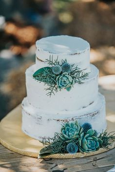 Rustic Chic KatiKati Orchard Wedding simple white iced wedding cake with blue + green florals + succulents Succulent Wedding Cakes, Floral Wedding Cakes, Wedding Cake Rustic, White Wedding Cakes, Elegant Wedding Cakes, Cool Wedding Cakes, Wedding Cake Designs, Wedding Cake Toppers, Trendy Wedding