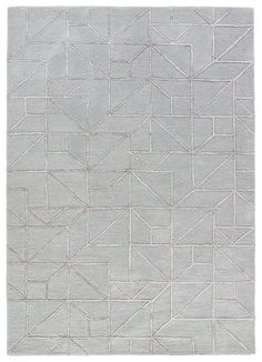 Over scaled sharp geometrics characterize this striking contemporary range of hand tufted rugs. The high/low construction in wool and viscose creates texture and surface interest and gives a look of matte and shine.