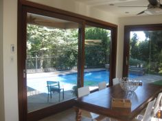 Panoramic Lift & Slide Door System opening up to the backyard and pool