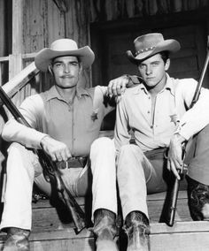 Lawman - TV western 1958-1962 - starring John Russell as Marshal Dan Troop of Laramie, WY with Peter Brown as Deputy Johnny McKay.  Peter Brown also starred in 3 episodes of The Virginian