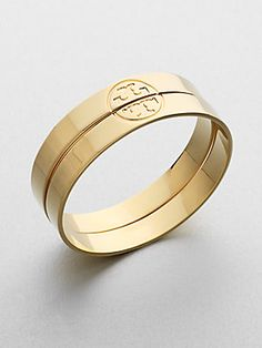 """Twin Logo Bangles by Tory Burch.  (set of 2) 16k gold plated (also comes in silver), 2.5"""" Diameter.  Neiman Marcus/Norstrom/Saks $165"""