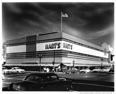 Image of the exterior of the Hart's department store in downtown San Jose, California. On the far right of the image, hidden behing a Hart's sign, the dome of the St. Joseph's Cathedral.