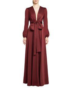 "<ul><li>Gorgeous gown featuring oversized sash at waist</li><li>Plunging V-neck</li><li>Long bishop sleeves</li><li>Empire waist</li><li>Oversized self-tie sash at waist</li><li>Concealed back zip with hook-and-eye closure</li><li>Pleated floor-length skirt</li><li>Acetate taffeta lining</li><li>About 62"" from shoulder to hem</li><li>Polyester</li><li>Dry clean</li><li>Imported</li><li>This item will arrive with a tag attached and instructions for removal. Once tag is removed, this item…"
