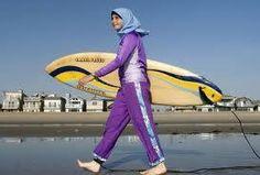 Sama Wareh walks on the sand in Newport Beach dressed in swim wear designed for Muslim women.