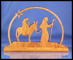 Christmas decorations of Mary, Joseph and the baby Jesus. I cut the scene from thick cherry and the base is thick with a routed ed. Nativity Creche, Christmas Nativity, Christmas Wood, Christmas Angels, Christmas Crafts, Christmas Decorations, Nativity Sets, Christmas Ideas, Christmas Ornaments