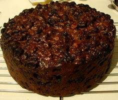 """""""This cake is a rich, dark, moist fruit cake, very flavorful at Christmas. Try icing with almond paste for a more festive touch. This recipe is started in October or November so as to let"""