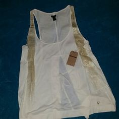 True Religion tank top. Size small. Small True Religion tank top. Brand new/never worn. Gold glitter stripes on it. Slit down the back with ties. Very cute!  True Religion online has it for full price! True Religion Tops Tank Tops