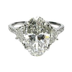 J BIRNBACH - Oval Diamond Ring with Half Moons in Platinum Gorgeous 3.04 carat Oval shape diamond flanked by a pair of half moon shape diamonds on a band of tiny diamonds. Perfectly proportioned, this ring displays seamless diamond beauty. $52,680
