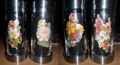 Toiletpaperrolls painted black and decorated with pictures of flowers, then stuffed inside the candlesticks.