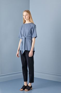 Kuwaii Radian Top features a back overlay which comes into long ties that can be tied and worn in several ways. The Radian top features a slightly rounded neckline and is made in soft draped Tencel fabric. We have added a set in sleeve to this style for winter, making this a great piece for all year around.  — Floaty, free fit silhouette — Elbow length kimono style sleeve — Slightly curved hemline to longer hip length — Ties can be worn in many different ways — Also available as a dress…