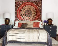 A Texture Adventure: Playing with visually engaging prints and textures keeps the eye moving and energizes a room. Ellen Pompeo's Hollywood Hills bedroom draws upon Indian, Egyptian, and West African designs for a bed that we'd want to luxuriate in for ho