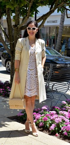 Trench coat with the sleeves pushed up...l love this look! And the dress is gorgeous.