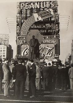 Times Square 1940s Men by Coca Cola and Planters Peanuts Sign in Duffy Square...with Father duffy Monument . City by Christian Montone, via Flickr