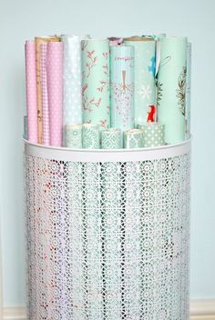 Use a Decorative Laundry Basket to Organize Wrapping Paper