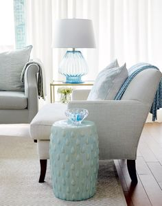Watery blues—The living room is awash in watery blues that are amplified in glass details for an airy, ethereal effect.