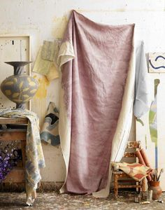 A dip-dyed linen tablecloth via Living Etc., photograph by Emma Lee.                   Above: Brittany of Oh Happy Day offers a thorough step-by-step tutorial on dip-dying a tablecloth.                   Above: Spotted on The Improvised Life (via Ikeas Livet Hemma): A half-painted drop cloth tablecloth with unhemmed edges.                   Above: A vibrant purple tablecloth, via House & Home.