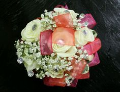 Coral and hot pink corsage with lots of bling. #promflowersrowlett #2floristgirls