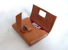 Handmade leather card holder, can hold 8+ credit cards Unique folding lock design keeps your card secure. Minimal stylish design. Vegetable Tanned Leather will be getting tanned and personalised item after time of use