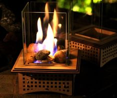 Make cold nights a little more bearable by lighting up one of these tabletop glass fireplaces. Each unit stands at about nine inches tall, assembles without the need for special tools, and provides great mood lighting that's ideal staying warm and/or making s'mores.