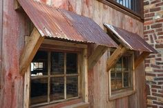 Interesting use of corrugated metal for window awnings. Need this on the garden shed!