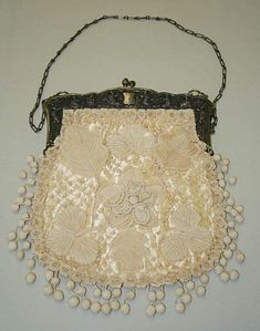 Vintage bag, late 19th century, probably French. 10 x 9 inches. (Looks like real handmade lace overlaid on silk, with a metal frame.) Metropolitan Museum of Art.