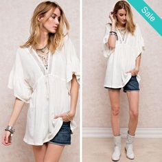 Lace up V-Neck Boho Blouse - Details Lace up V-Neck Boho Blouse Description: SOFT LIGHT COTTON SLUB WIDE 2/1 SLEEVE TUNIC. FEATURING LACE UP DETAILING AT THE V NECK NECKLINE. BOXY TUNIC. BACK IN STOCK Fabric: COTTON Content: 100% COTTON - On Sale for $36.00 (was $39.00)