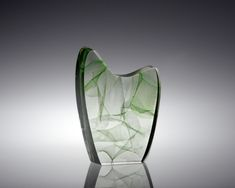 After graduating from the Academy of Visual Arts in Maastricht The Netherlands Michael Behrens started a remarkable career in glass art His work can now be seen in most major glass art galleries and collections in Europe and N America His large scale kiln cast highly polished glass sculpture reflects his fascination with the undersea world nbsp nbsp