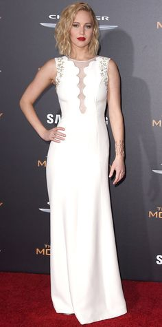 Jennifer Lawrence Jennifer Lawrence continued her fashionable streak for The Hunger Games: Mockingjay, Part 2 promo tour with a breathtaking illusion-paneled embellished off-white silk cadi Dior evening gown, with Graziela Gems jewelry, for the Los Angeles premiere.