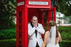 Ryan's favorite memory of their wedding day was seeing Kylie for the first time at the iconic red phone booth in EPCOT's UK Pavilion!