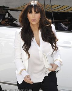 Working it! Kim Kardashian premiered her new fringe during a shopping trip with her sister Kourtney at Bel Bambini in LA on Wednesday