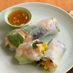 Shrimp and Mango Summer Dipping Rolls with Sweet and Spicy Dipping Sauce ~ Skip the fried egg rolls and make these light, refreshing rolls featuring shrimp, sweet mango, and mint. Each roll is around 75 calories so enjoy 2 alongside some brown rice and a hearty salad.