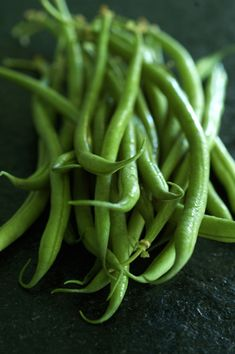 haricots verts. And what the fuck was an haricot vert anyway? Some kind of rich doctor French green beans he'd turned her on to. She was always grabbing them out of his fridge.
