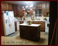 Kitchen before we painted it.  Miss the granite top island but not all that dark oak.