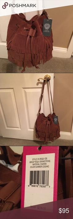 Host Pick 🎉🎈🎉NWT VINCE CAMUTO BUCKET BAG Host Pick 🎉🎈NWT Vince Camuto bucket bag with drawstring top and 3 layers of suede fringe.  Beautiful cognac suede bag with leather drawstring and shoulder strap.  Comes with dust bag. Vince Camuto Bags Shoulder Bags