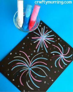 Have your kids make a fireworks craft for the 4th of July using wet chalk and a piece of paper. It's a super easy art project that you can make for memorial day as well.
