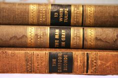 what fantastic titles.  Mid Century Mystery Books, Set of 3. $11.95, via Etsy.