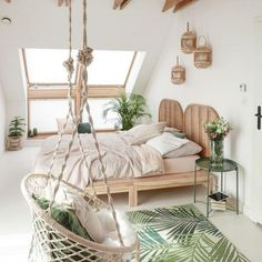 Hanging macrame chair in boho bedroom #homedecor  // Shop now at www.wallandroom.com Follow us on instagram: @wallandroom
